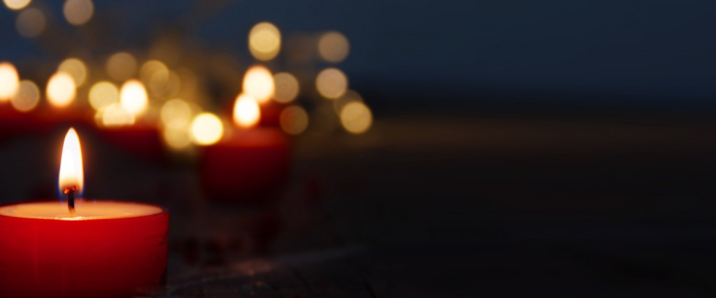 Lots of candles on dark background